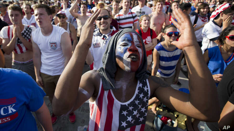 Soccer fan Collins Fon reacts as he watches the USA vs Belgium World Cup soccer match in Washington, July 1, 2014.