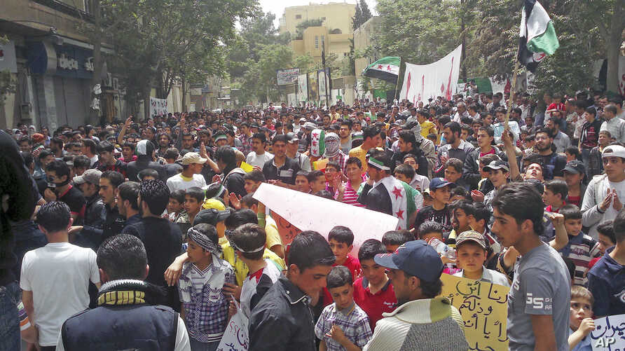 Demonstrators protest against Syria's President Bashar Al-Assad after Friday prayers in Yabroud, near Damascus, May 11, 2012.