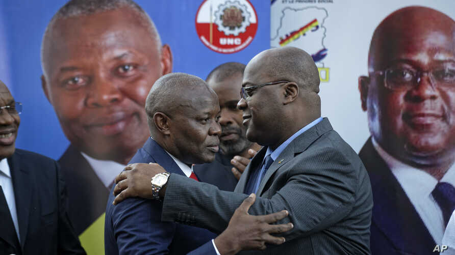FILE - Felix Tshisekedi (R) of Congo's Union for Democracy and Social Progress opposition party, hugs Vital Kamerhe (L) of Congo's Union for the Congolese Nation opposition party, after being endorsed Kamerhe at a press conference in Nairobi, Kenya,