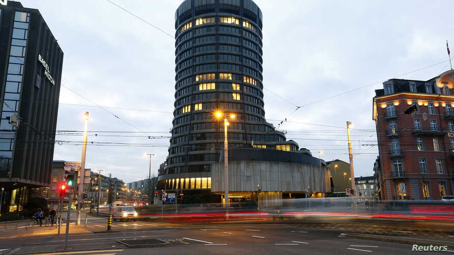 FILE - Traffic flows in front of the Bank for International Settlements (BIS) in Basel, Switzerland.