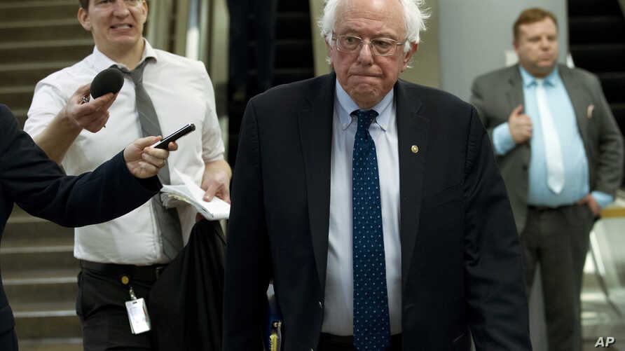 Sen. Bernie Sanders, I-Vt., heads to his office, as the Senate takes up a House-passed bill that would pay for President Donald Trump's border wall and avert a partial government shutdown, at the Capitol in Washington, Dec. 21, 2018.