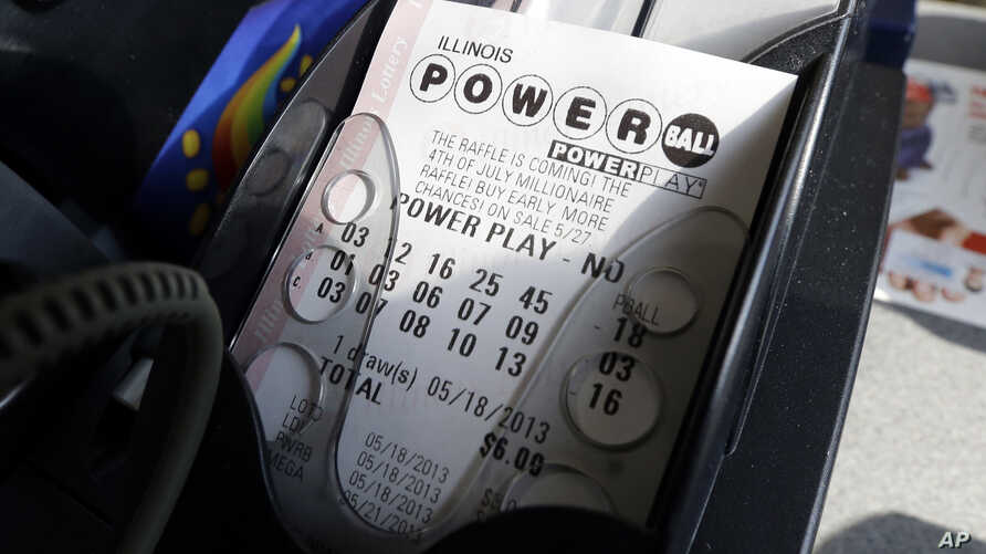 FILE - A Powerball lottery ticket is printed out of a lottery machine at a convenience store in Chicago, Illinois.