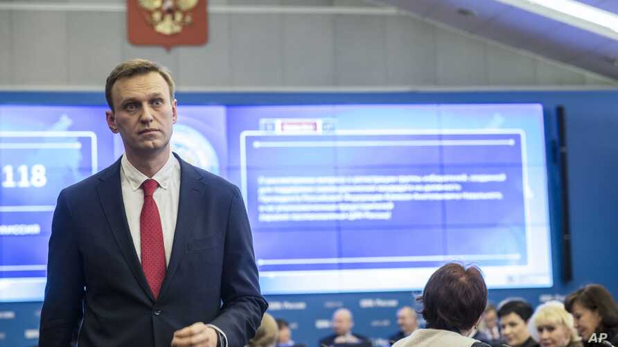 FILE - Russian opposition leader Alexei Navalny stands at Russia's Central Election commission in Moscow, Russia, Dec. 25, 2017.