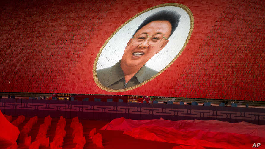 """A portrait of late North Korean leader Kim Jong Il is formed during the """"Glorious Country"""" mass games held in conjunction with the 70th anniversary of North Korea's founding day in Pyongyang, North Korea, Sept. 9, 2018."""
