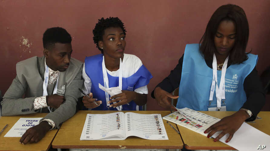Voter officials at their stations during presidential elections in Luanda, Angola, Aug. 23, 2017.