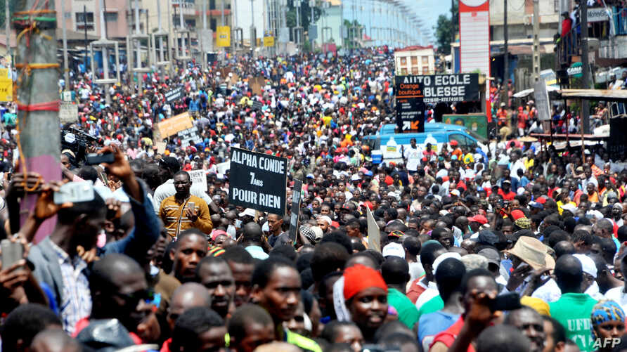 Guinea's opposition supporters walk during a demonstration in Conakry, Aug. 2, 2017.