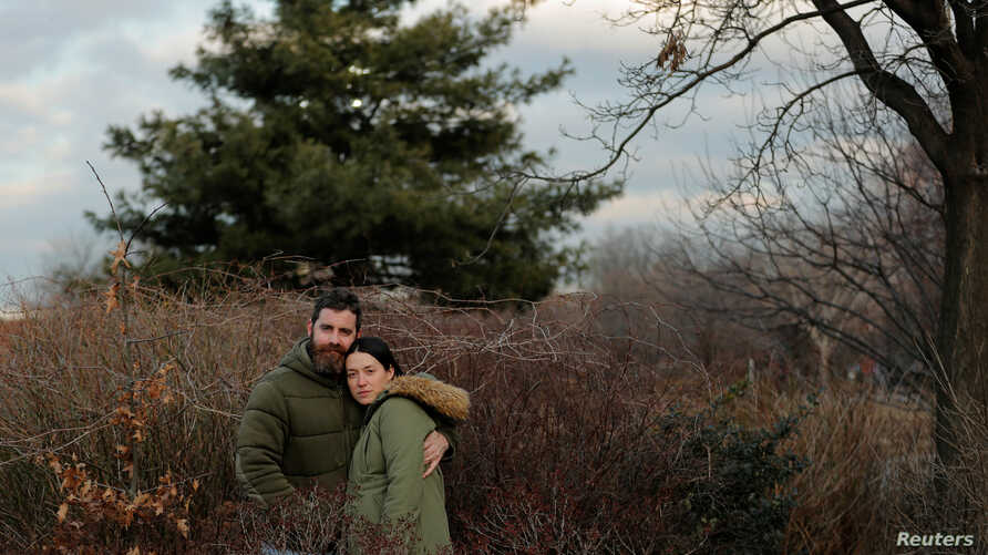 Jenny Ostrom, 37, a director of photography and her husband Chad Ostrom, 37, a director, stand in McCarren Park, near their home in the Brooklyn borough of New York, U.S., February 8, 2018.