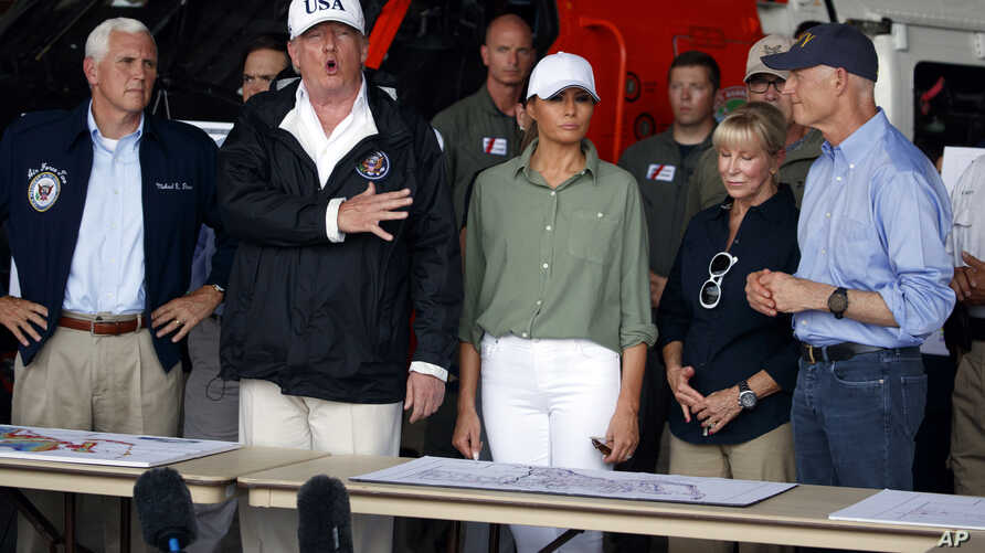 President Donald Trump, first lady Melania Trump and Vice President Mike Pence, left, participate in a briefing on the Hurricane Irma relief efforts, Sept. 14, 2017, in Ft. Myers, Fla., after arriving at Southwest Florida International airport.