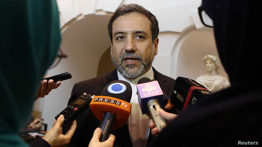 Iran's top nuclear negotiator Abbas Araqchi talks to journalists after meeting senior officials from the United States, Russia, China, Britain, Germany and France in a hotel in Vienna, Austria, October 19, 2015. Abbas said on Monday he expected an hi