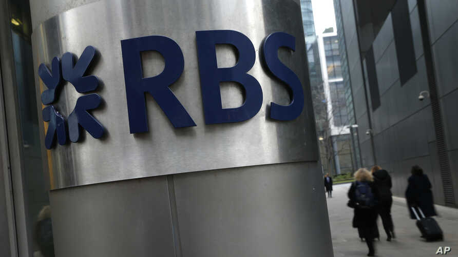 FILE - People walk past one of the headquarters buildings showing the logo of the Royal Bank of Scotland in London, Jan. 26, 2017.