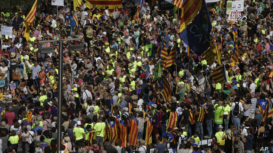 Demonstrators pack on of the main squares in Barcelona, Spain, Sept. 24, 2017