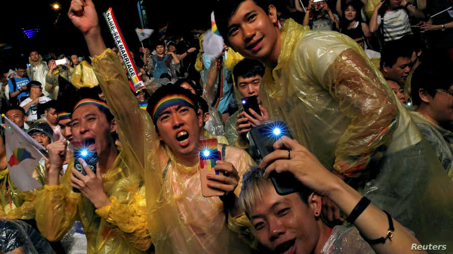 FILE - Supporters attend a rally after Taiwan's constitutional court ruled that same-sex couples have the right to legally marry, the first such ruling in Asia, in Taipei, Taiwan, May 24, 2017.