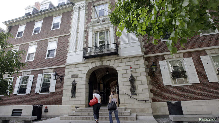 FILE - Students walk into Kirkland House on the campus of Harvard University in Cambridge, Mass.