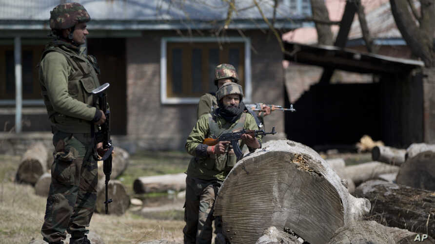 Indian army soldiers stand guard outside an army base where the bodies of suspected rebels are being kept, near the site of a gun battle in Hajin village, north of Srinagar Indian controlled Kashmir, March 22, 2019.