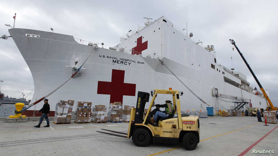 FILE - Supplies are loaded into the San Diego-based hospital ship USNS Mercy as it prepares for possible deployment to aid the typhoon-stricken areas of the Philippines from its port in San Diego, California, Nov. 15, 2013.