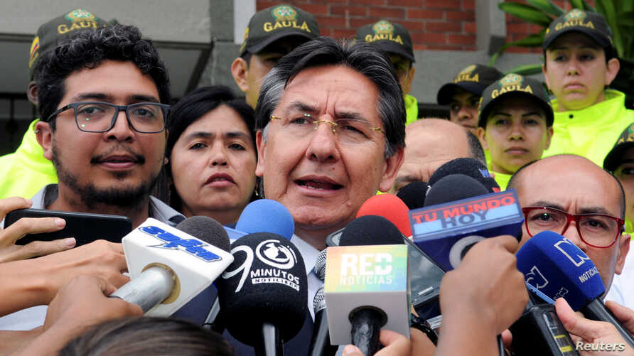 Colombia's Attorney General Nestor Humberto Martinez addresses the media, after the bodies of two Ecuadorean journalists and their driver, killed two months ago while being held captive by Colombian insurgents, have been found and identified, in Cali