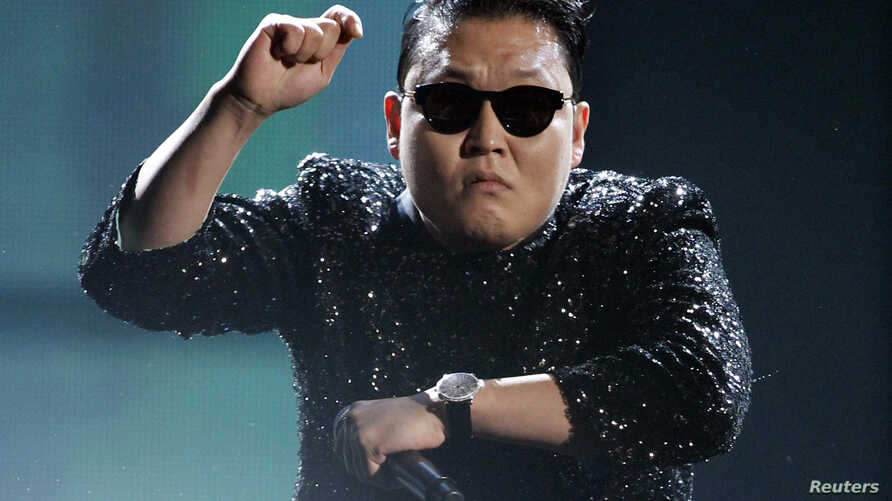 """South Korean pop artist Psy performs """"Gangnam Style"""" at the 40th American Music Awards in Los Angeles, California, November 18, 2012."""