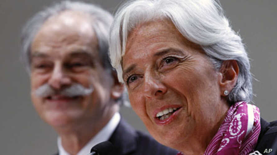 IMF Managing Director Christine Lagarde holds a news briefing at the International Monetary Fund headquarters in Washington July 6, 2011