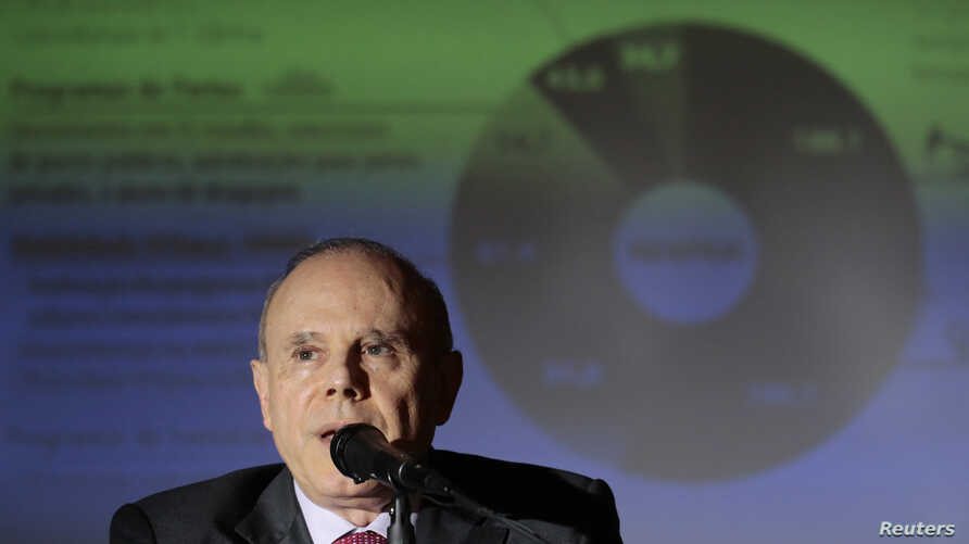 Brazil's Finance Minister Guido Mantega speaks during the announcement of cuts in the Federal Budget, at the Finance Ministry in Brasilia, Feb. 20, 2014.