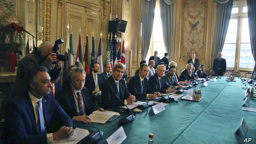 U.S. Secretary of State John Kerry, third left, and France's Foreign Minister Jean Marc Ayrault, fifth left, attend a meeting with others on Syria in Paris, Saturday, Dec. 10, 2016.