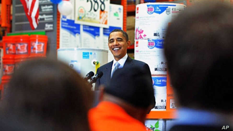 US President Barack Obama delivers a speech on economic impact of energy saving home retrofits at a Home Depot in Alexandria, Virginia, 15 Dec 2009