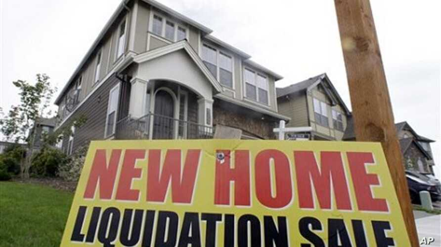New home liquidation sign is seen in front of a home in Happy Valley, Oregon