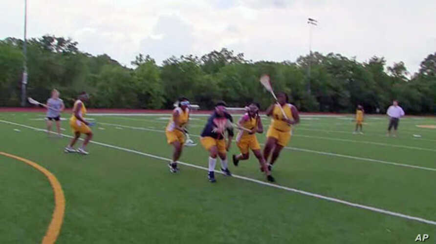 Some of the girls on the lacrosse team at Ballou High School in Washington, D.C., run a drill on the practice field, May 2011