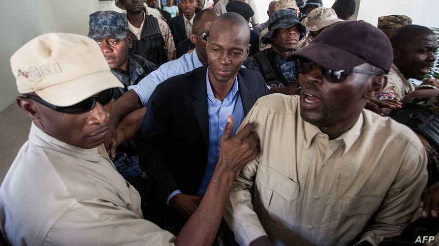 Haiti's President-elect Jovenel Moise returns from the Cabinet d'instruction to the Public Prosecutor's Office in Port-au-Prince, Jan. 25, 2017.