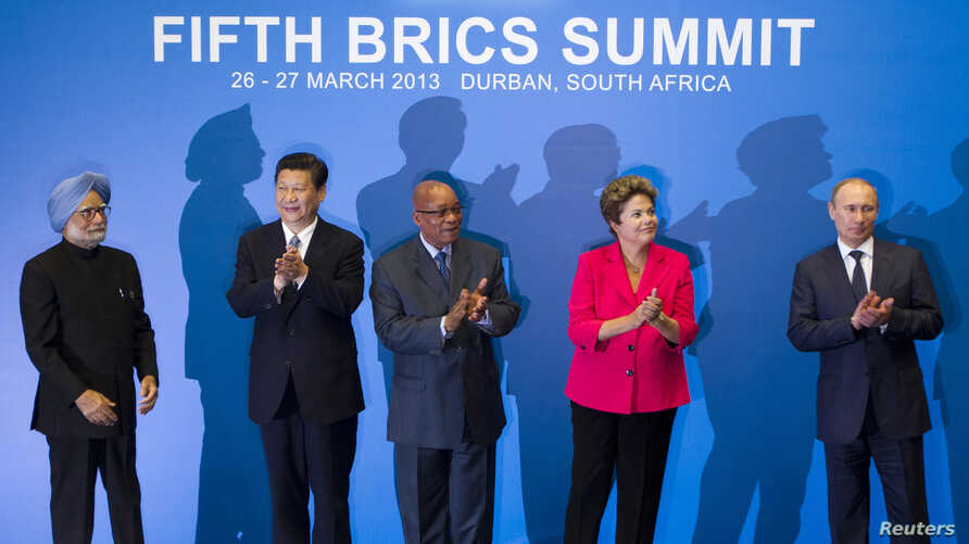 Indian PM Manmohan Singh, Chinese President Xi Jinping, South African President Jacob Zuma, Brazilian President Dilma Rousseff and Russian President Vladimir Putin applaud at a family photo session during the fifth BRICS Summit in Durban, March 27, 2