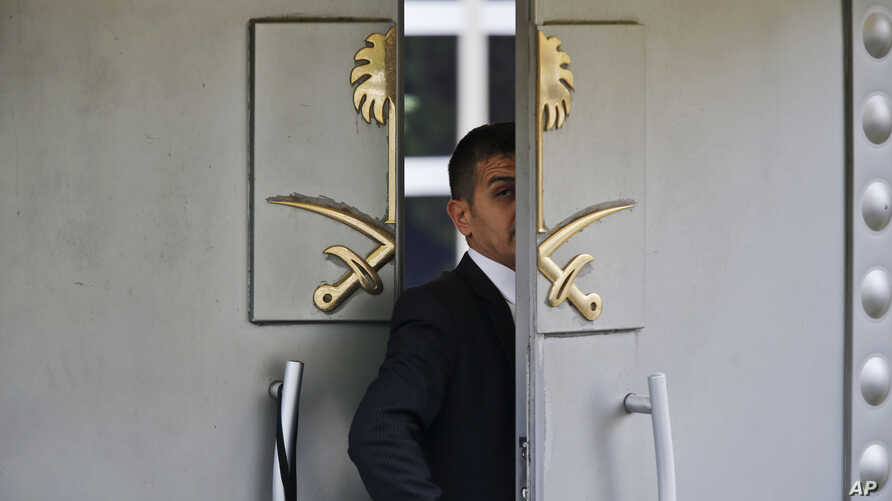 A security guard walks in the Saudi Arabia consulate in Istanbul, Tuesday, Oct. 9, 2018. Turkey said Tuesday it will search the Saudi Consulate in Istanbul as part of an investigation into the disappearance of Jamal Khashoggi, a missing Saudi contrib
