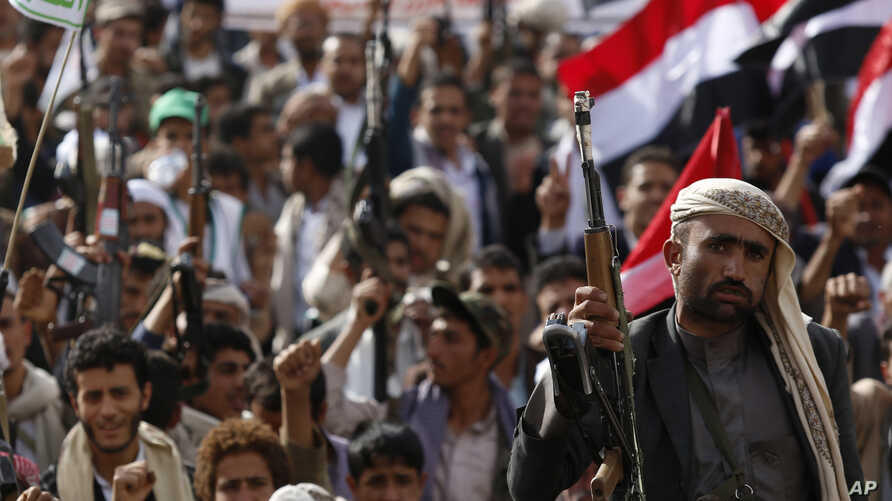 A Shi'ite Houthi rebel holds up his weapon during a rally against Saudi-led airstrikes in Sana'a, Yemen, June 14, 2015.