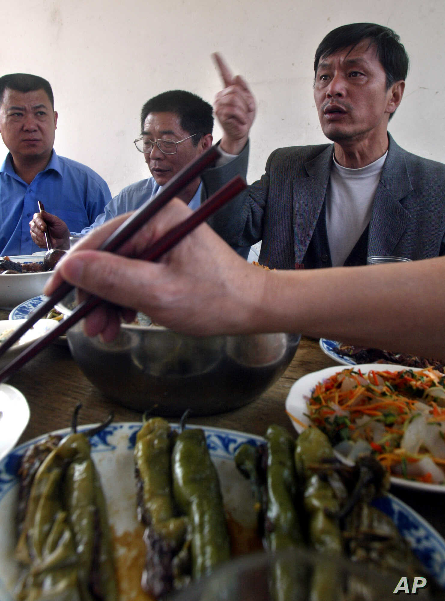 FILE - Xiang Nanfu at an Easter meal at a brick home in Houbaihujian village, on the outskirts of Beijing, China, April 11, 2004.