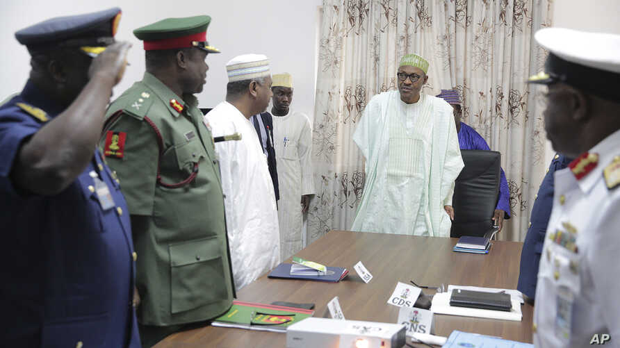 Nigerian President Muhammadu Buhari presides at a meeting with his nation's service chiefs in Abuja, June 2, 2015.