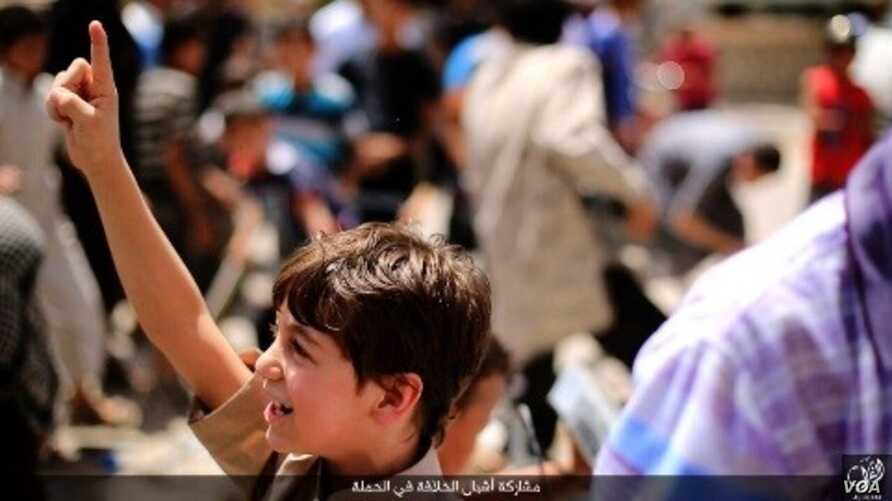 A young boy being trained in an Islamic State-run school volunteers for a suicide bombing. Source: Aaamaq IS channel