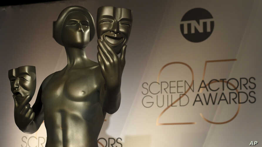 FILE - A Screen Actors Guild statue appears on stage at the nominations announcement for the 25th annual Screen Actors Guild Awards at the Pacific Design Center on Dec. 12, 2018, in West Hollywood, Calif.