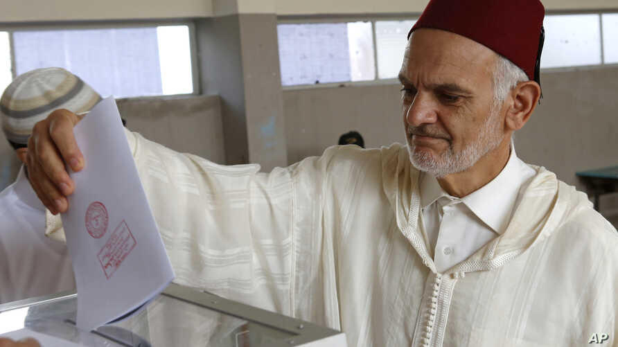 A Moroccan man casts his ballot at a polling station in parliamentary elections, in Rabat, Morocco, Oct. 7, 2016.