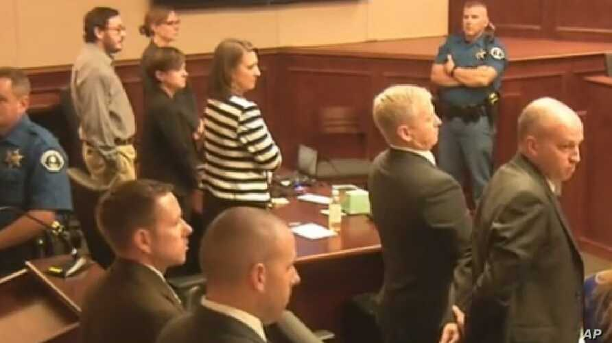 In this image made from Colorado Judicial Department video, Defendant James Holmes, top left in tan shirt, defense attorneys, top left, and prosecuting attorneys watch as the jury exits the courtroom after delivering their sentencing verdict in the C