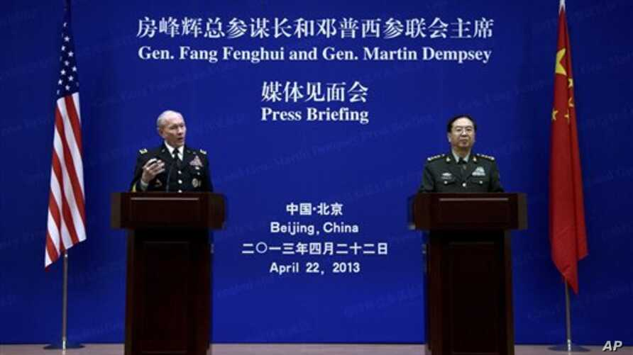U.S. Joint Chiefs Chairman Gen. Martin Dempsey, left, speaks alongside Chinese counterpart Gen. Fang Fenghui, Bayi Building, Beijing, April 22, 2013.