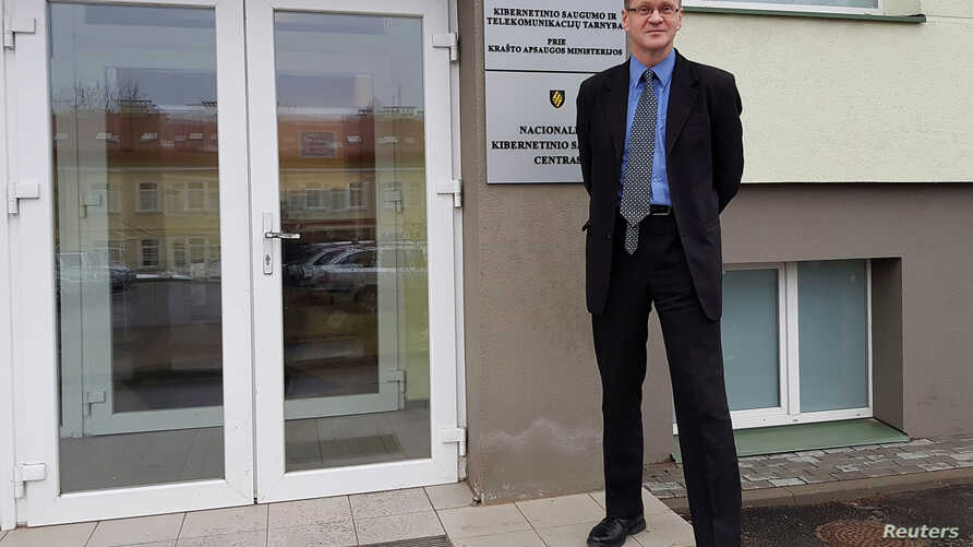 Head of Lithuania's National Cyber Security Center, Rimtautas Cerniauskas, poses for a picture in Vilnius, Lithuania, Dec. 21, 2016.