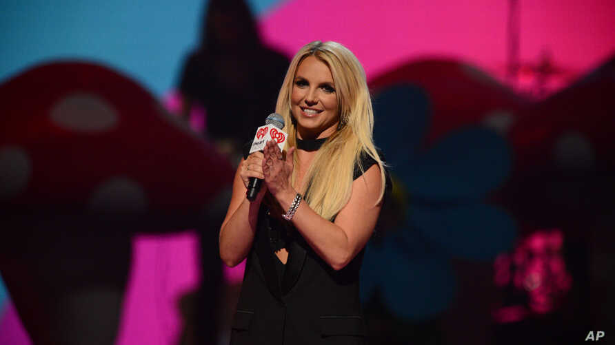 Britney Spears introduces Miley Cyrus at iHeartRadio Music Festival, day 2, Sept. 21, 2013 in Las Vegas, NV.