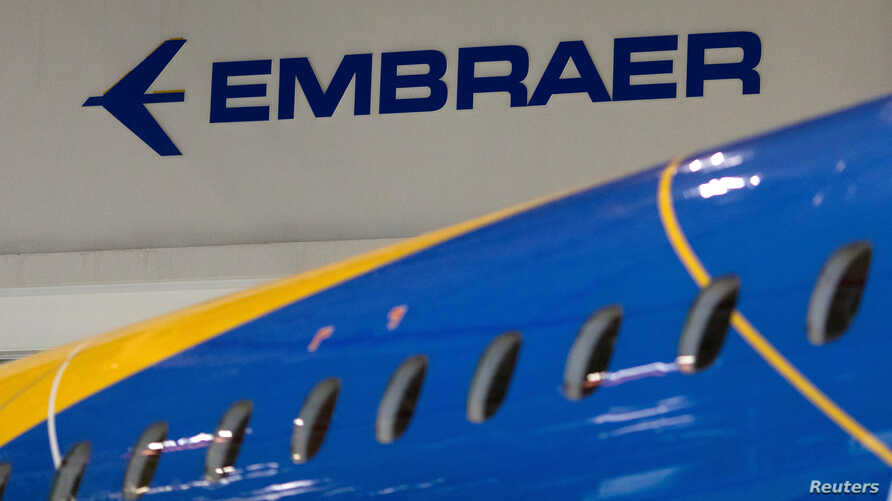 FILE - The logo of Brazilian planemaker Embraer SA is seen at the company's headquarters in Sao Jose dos Campos, Brazil, Feb. 28, 2018.