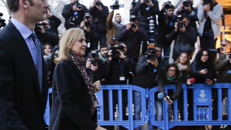 Spain's Princess Cristina and her husband Inaki Urdangarin arrive at a makeshift courtroom for a corruption trial, in Palma de Mallorca, Spain, Monday, Jan. 11, 2016.