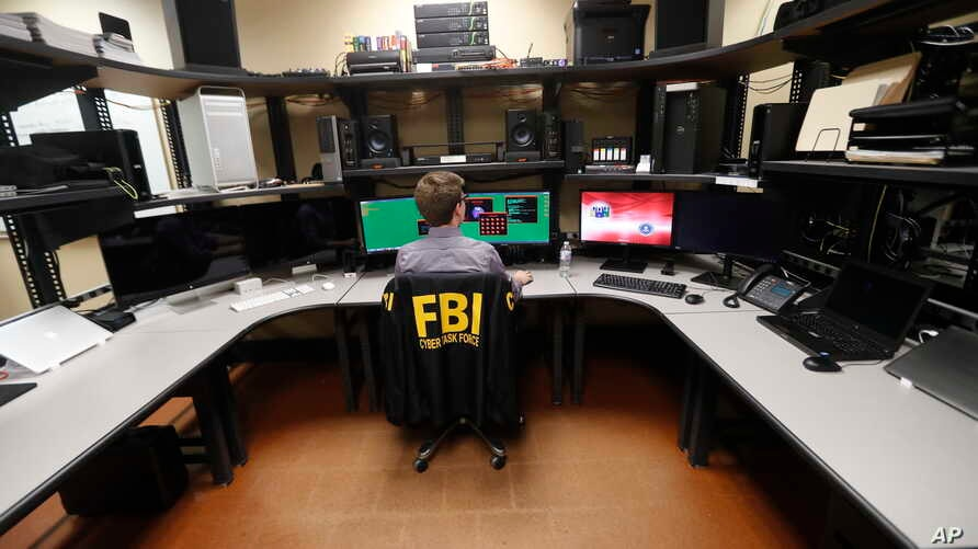 FILE - An FBI employee works in a computer forensics lab at the FBI field office in New Orleans.