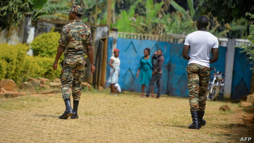 FILE - Government soldiers are seen on patrol in Bafut, in the restive northwest English-speaking region of Cameroon, Nov. 15, 2017.