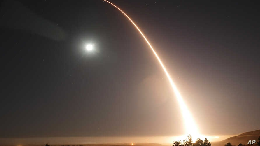 FILE - In this image taken with a slow shutter speed and provided by the U.S. Air Force, an unarmed Minuteman 3 intercontinental ballistic missile launches during an operational test just after midnight, May 3, 2017, at Vandenberg Air Force Base, Cal