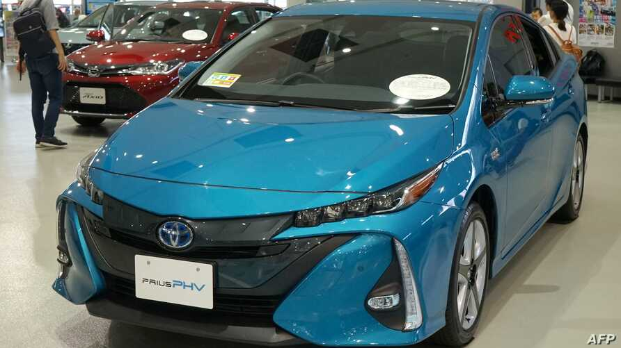 Toyota Motor's latest cars are exhibited at their showroom in Tokyo on Aug. 3, 2018. Japanese car giant Toyota on Aug. 3, 2018, said its first quarter net profit rose 7.2 percent.