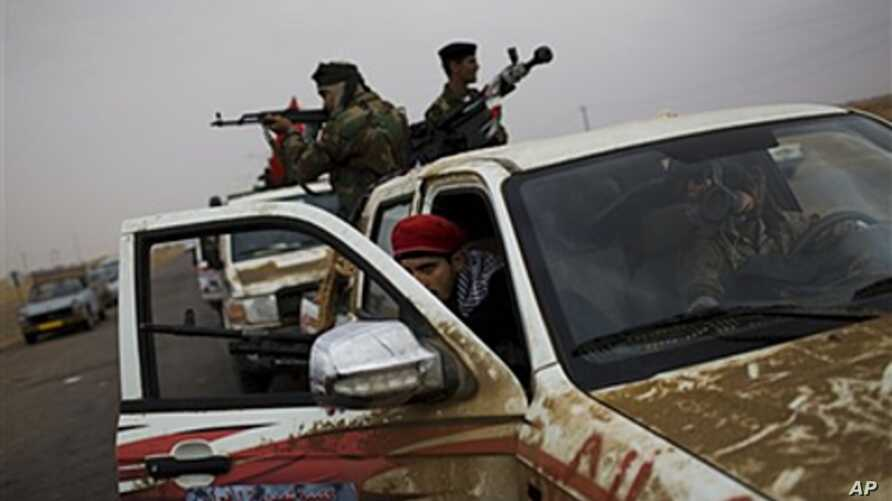 Libyan rebel fighters wait inside their cars before going to the front line, on the outskirts of Ajdabiya, April 20, 2011