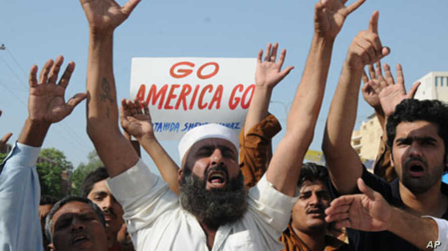 A Pakistani protester shout slogans at an anti-American rally to condemn the U.S. for accusing the country's most powerful intelligence agency of supporting extremist attacks against American targets in Afghanistan, in Multan, Pakistan, September 23,
