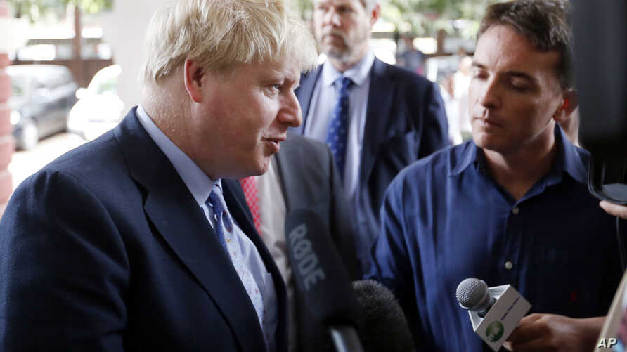 Britain's Foreign Secretary Boris Johnson, center, visits the Yangon General Hospital in Yangon, Myanmar, Jan. 21, 2017.