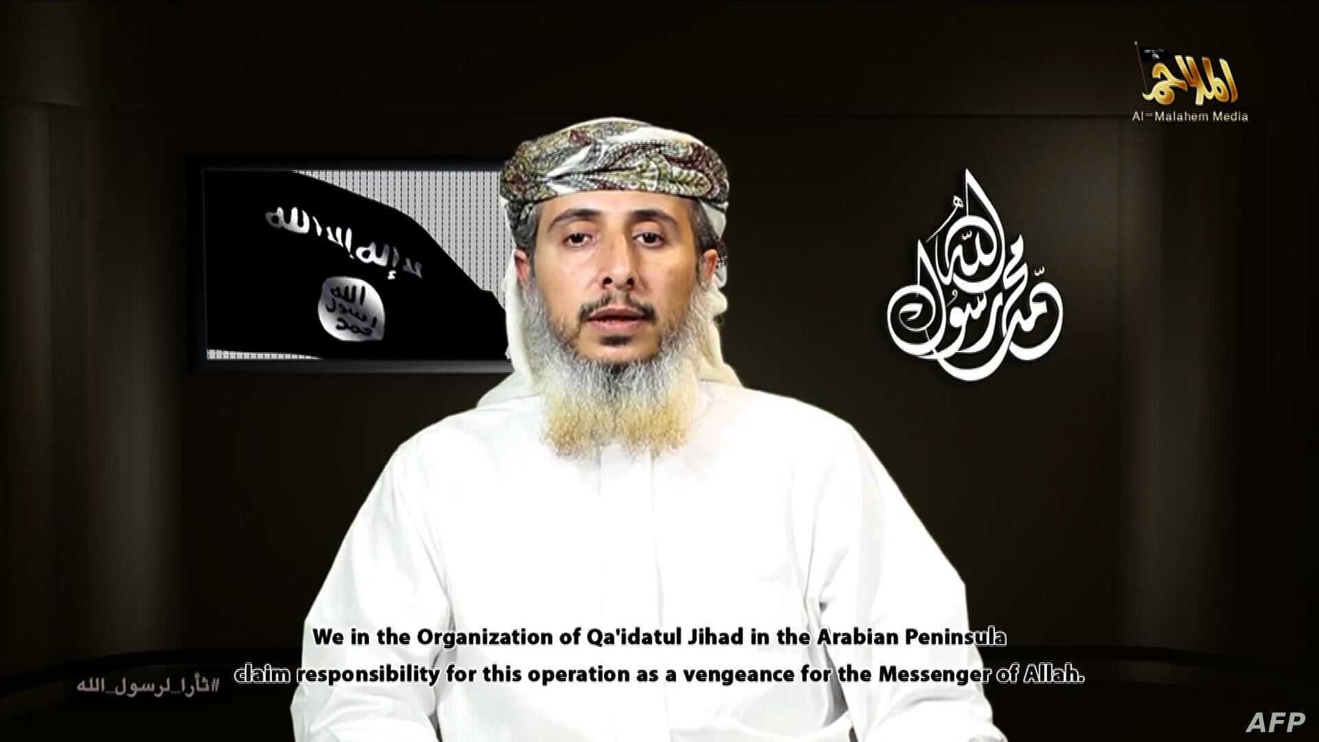 This image taken off a propaganda video posted online on January 14, 2015, by the media arm of Al-Qaeda in the Arabian Peninsula purportedly shows Nasser bin Ali al-Ansi delivering a video message claiming responsibility for the attack on the French ...